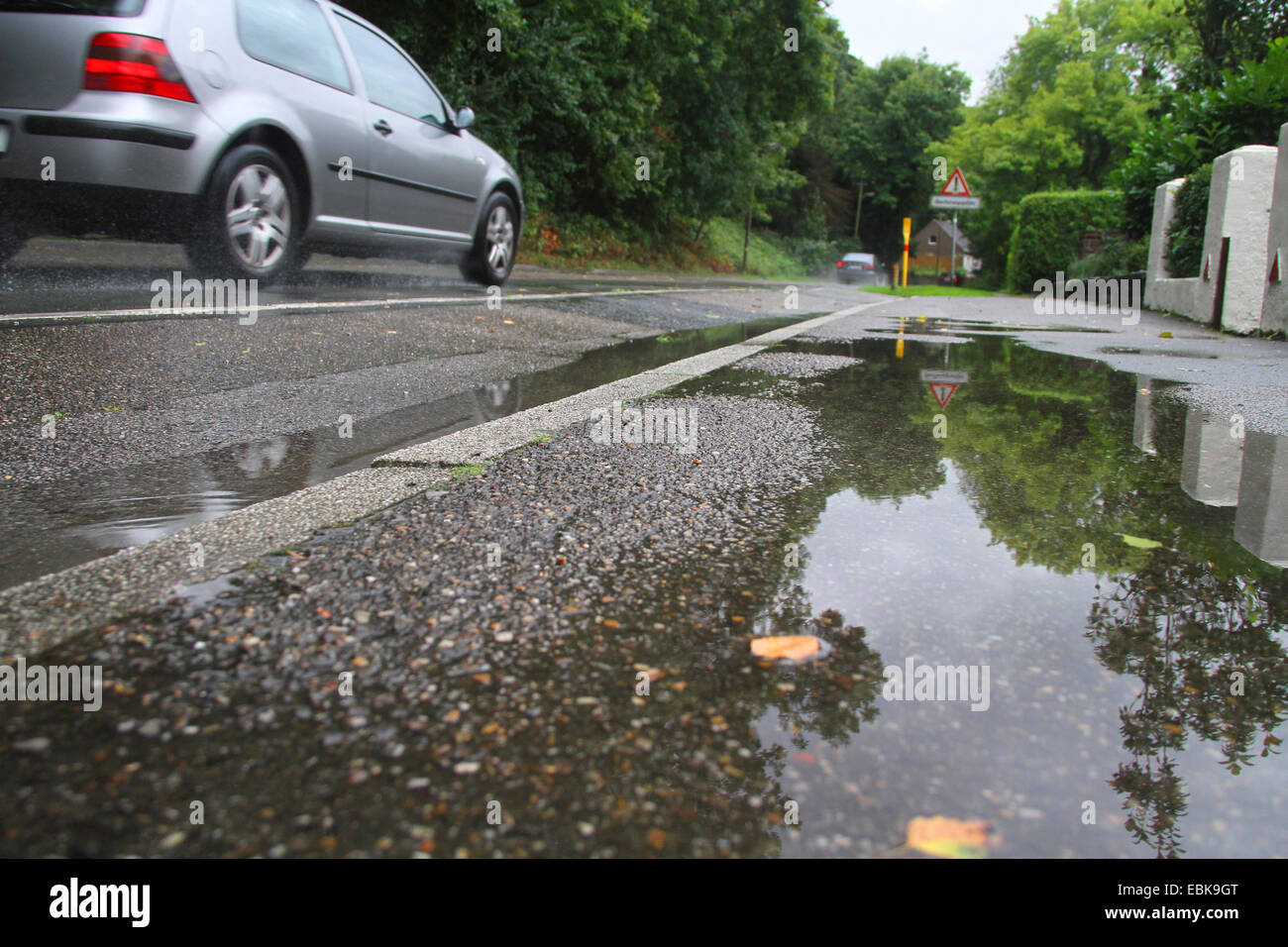 passenger car driving on a rain-wet road, Germany - Stock Image