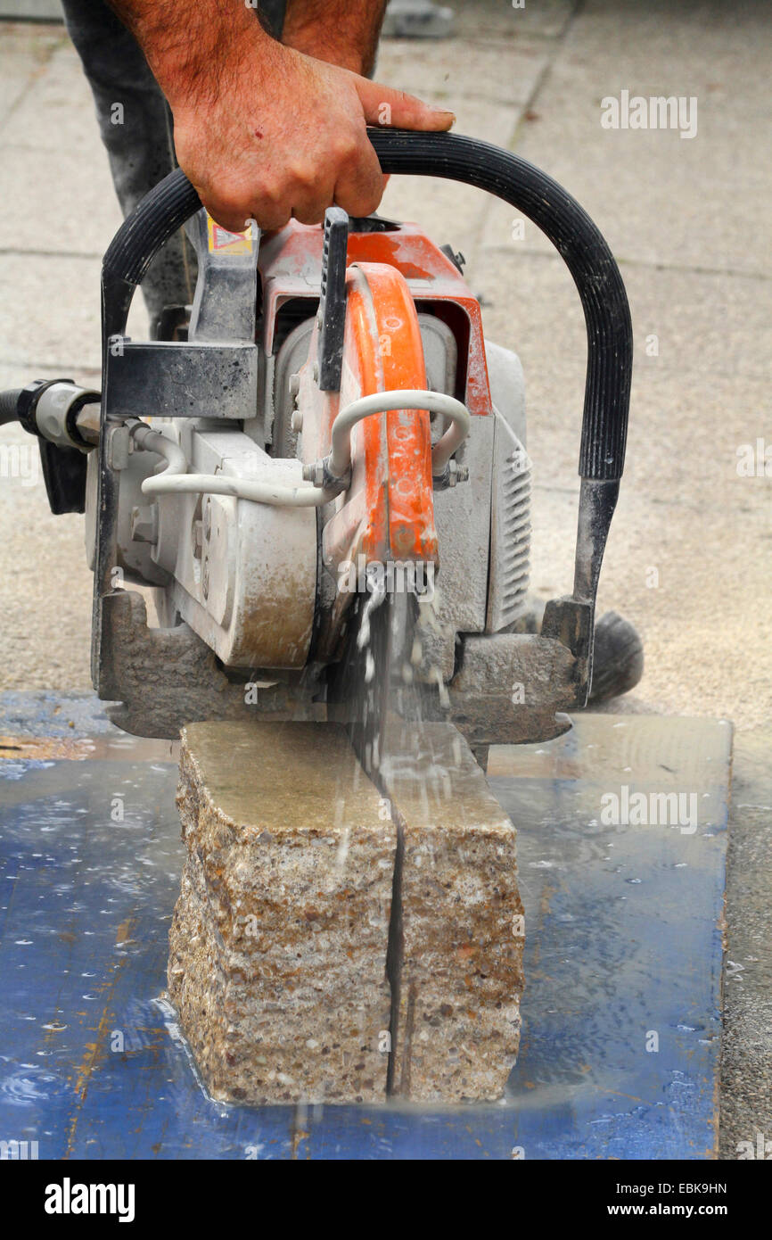 sawing stone without water and a lot of raising dust, Germany - Stock Image
