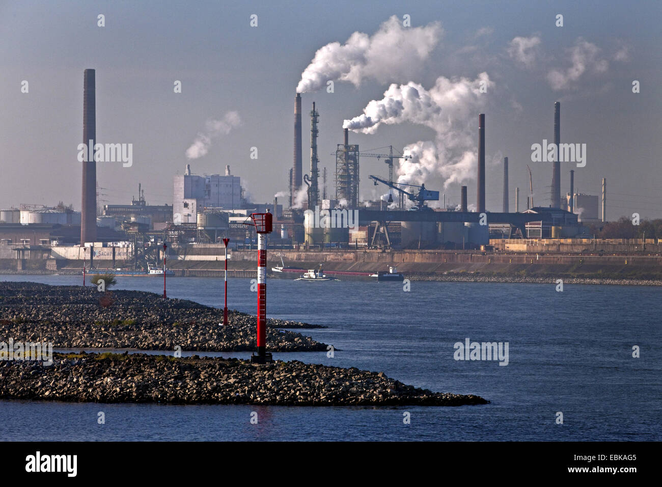 Ruhr flowing into Rhine, industrial scenery in background, Germany, North Rhine-Westphalia, Ruhr Area, Duisburg - Stock Image