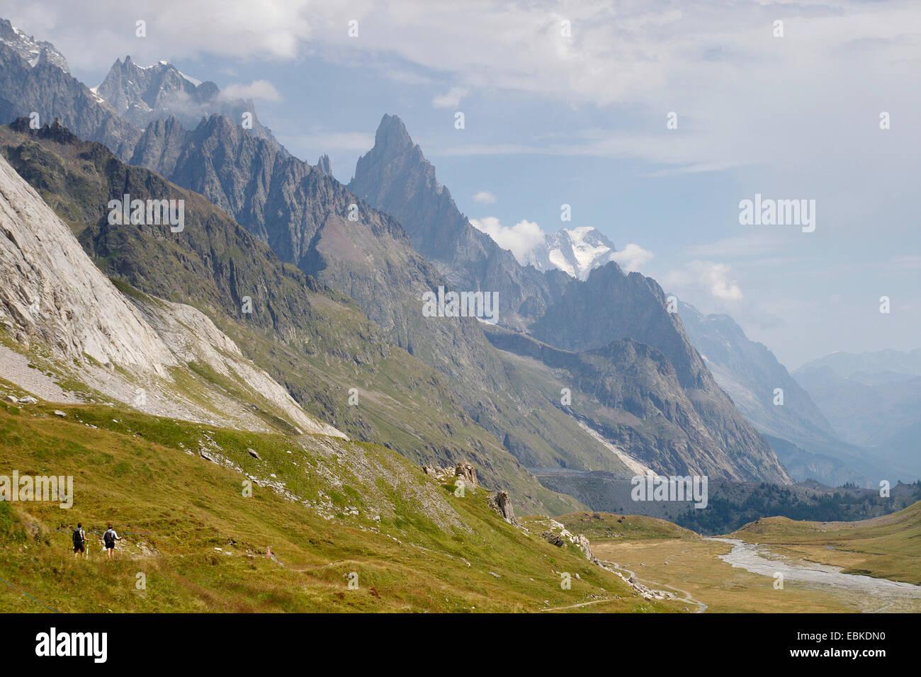 hiker in Val Veny, Aiguille Noire de Peuterey, Italy - Stock Image