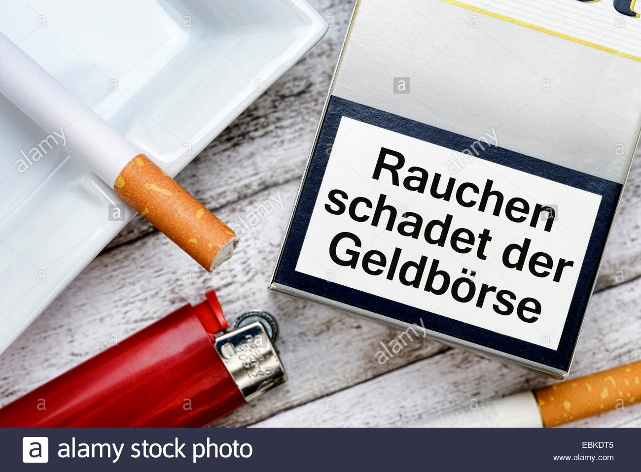 cigarette packet with the inscription 'Rauchen macht arm' ('Smoking harms your purse'), symbol photo - Stock Image