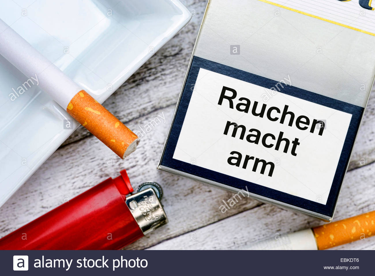 cigarette packet with the inscription 'Rauchen macht arm' ('Smoking makes you poor'), symbol photo - Stock Image