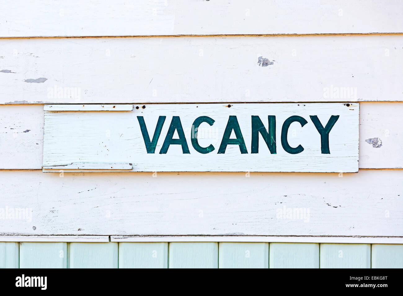 An old fashioned vacancy sign on an old motel. - Stock Image