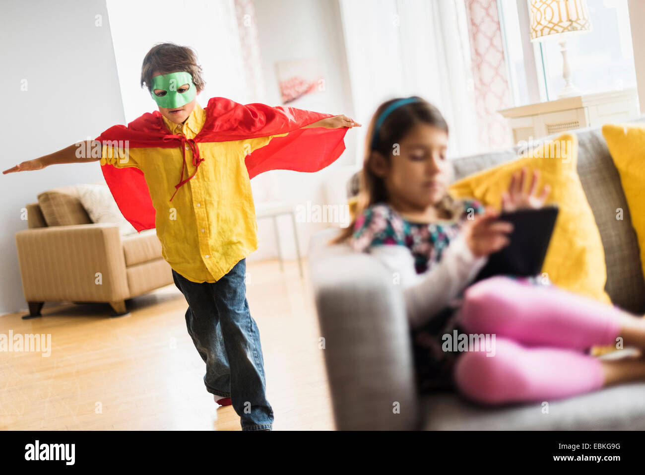 Children (6-7) playing at home - Stock Image