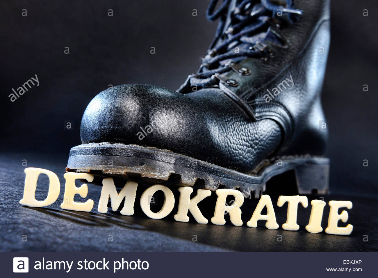 jump boot on democracy letters, right wing extremism - Stock Image
