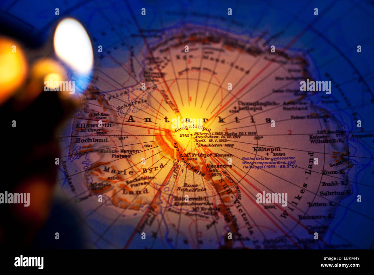 burning lighter above map of the Antarctic, symbol for global warming - Stock Image