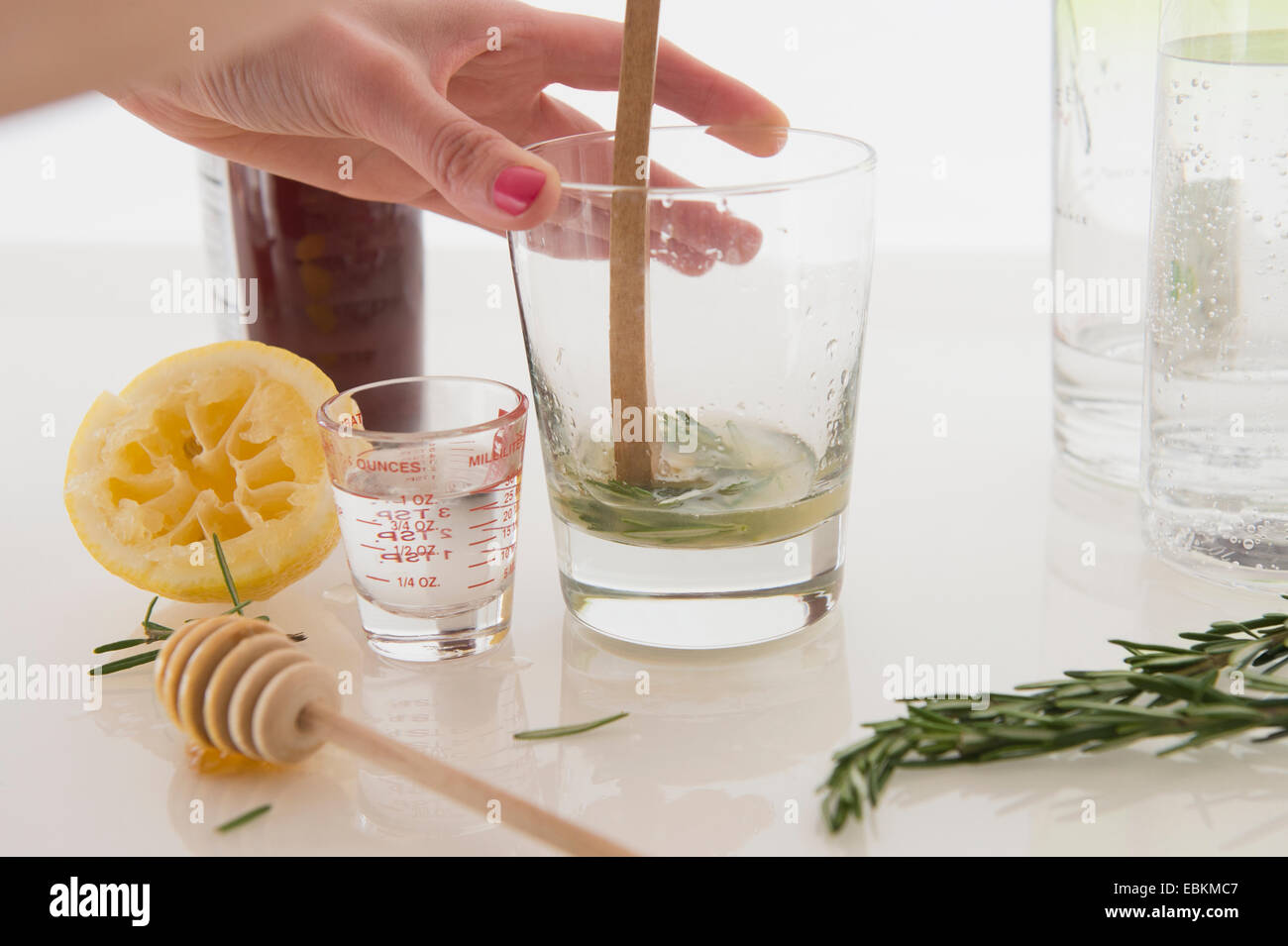 Woman making cocktail - Stock Image