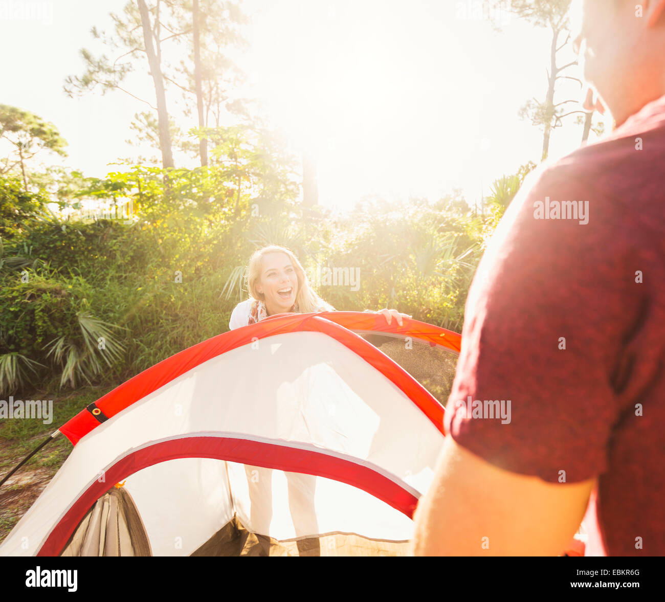 USA, Florida, Tequesta, Couple setting up tent in forest Stock Photo