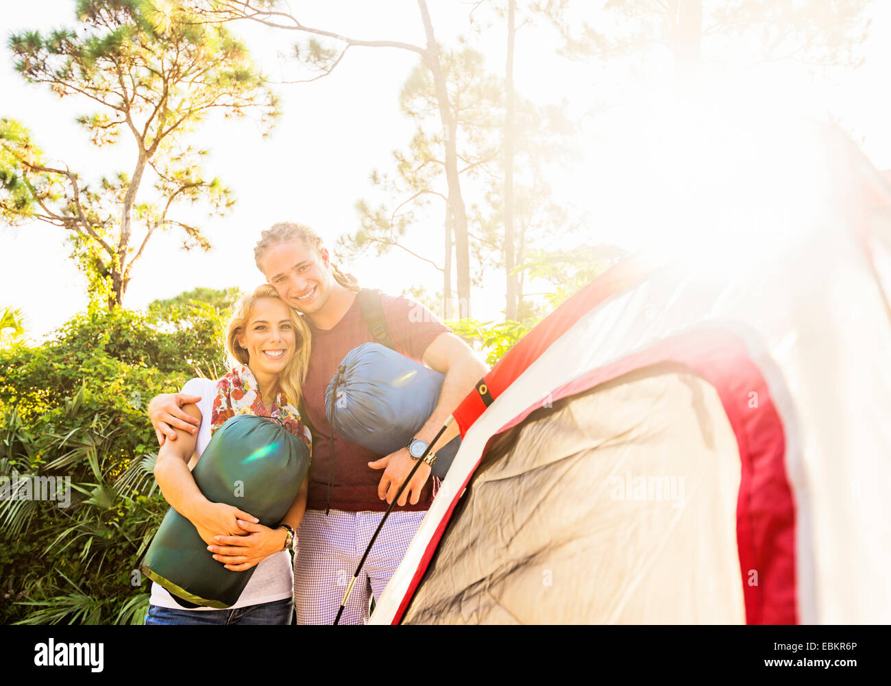 USA, Florida, Tequesta, Portrait of smiling couple standing together next to tent Stock Photo