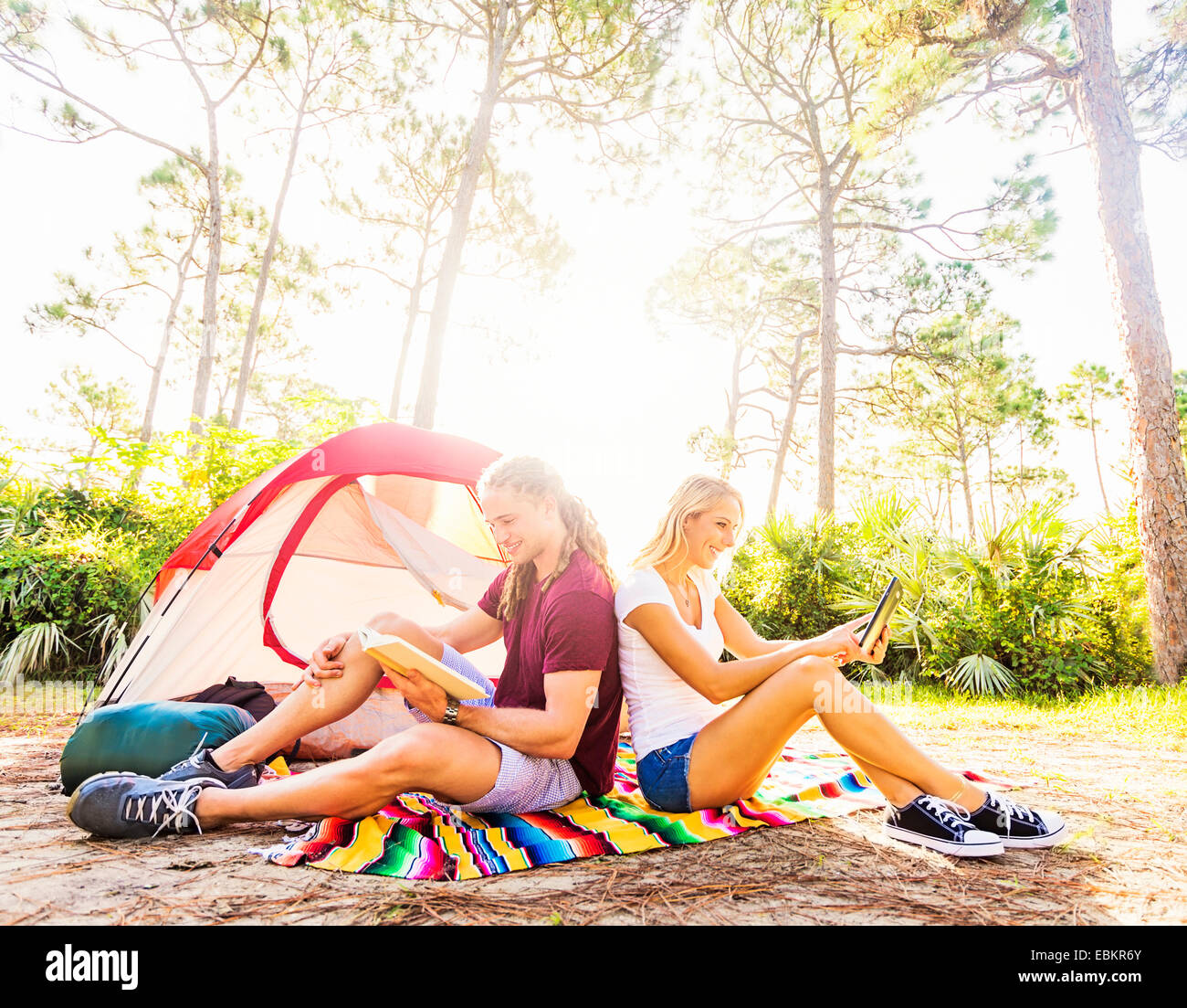 USA, Florida, Tequesta, Couple sitting in front of tent Stock Photo