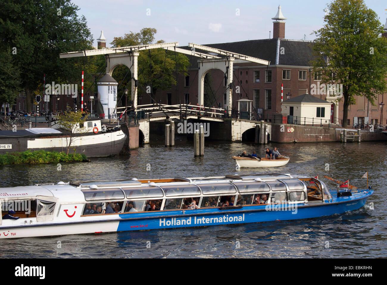 Wooden cantilever bridge along the Amstel River, Amsterdam, Netherlands, Europe - Stock Image