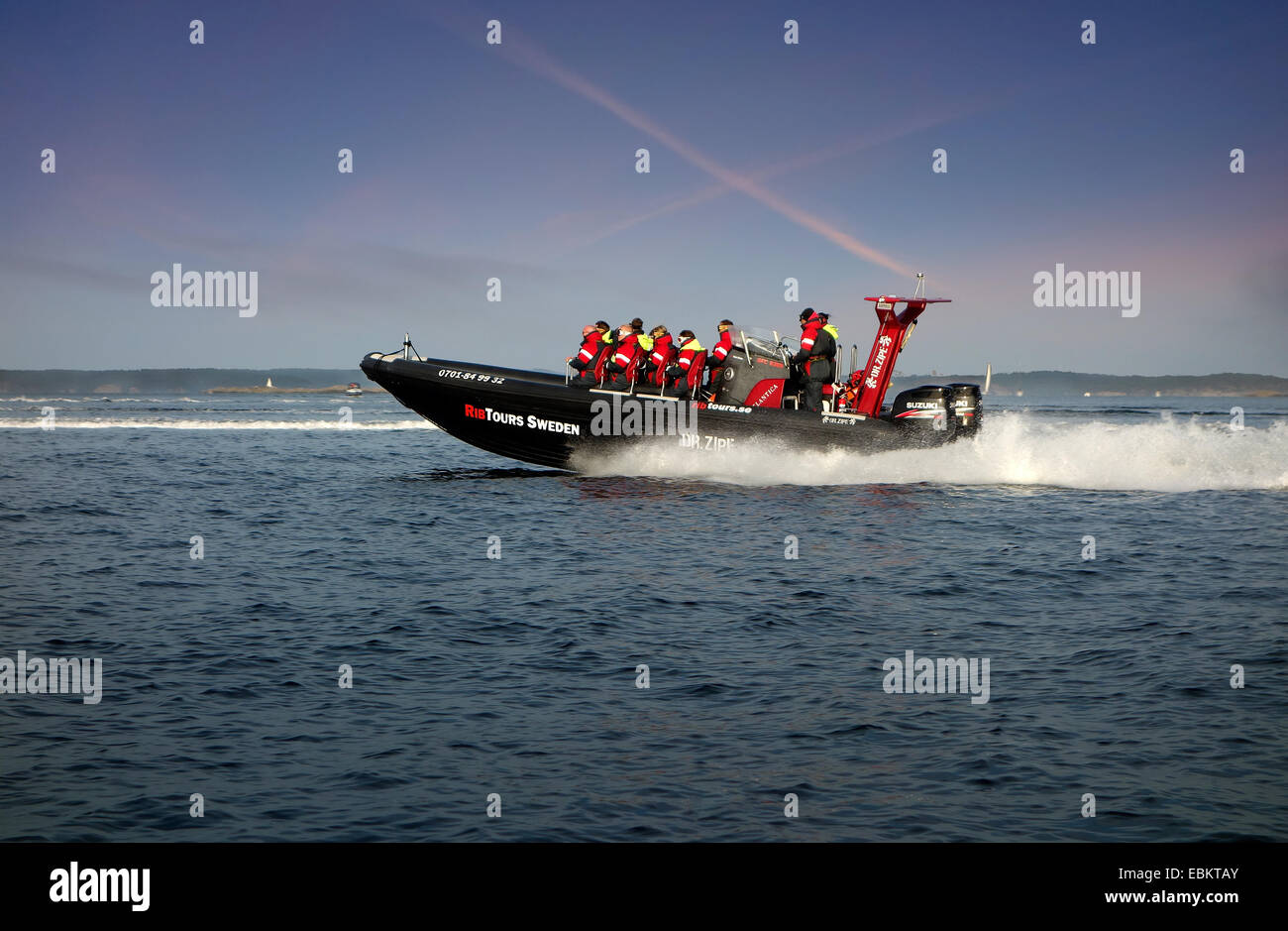 A light-weight high performance  rigid-hulled inflatable boat, (RHIB) or rigid-inflatable boat (RIB) in optimal - Stock Image