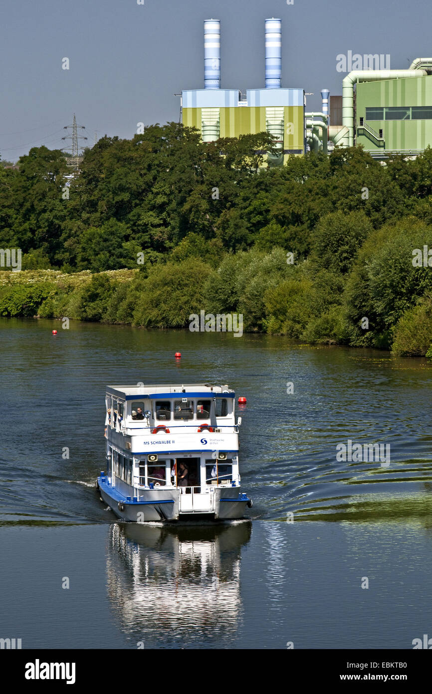 excursion boat on river Ruhr, steelworks in background, Germany, North Rhine-Westphalia, Ruhr Area, Witten - Stock Image