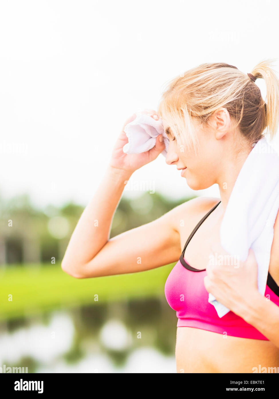 USA, Florida, Jupiter, Woman whipping sweat off forehead - Stock Image
