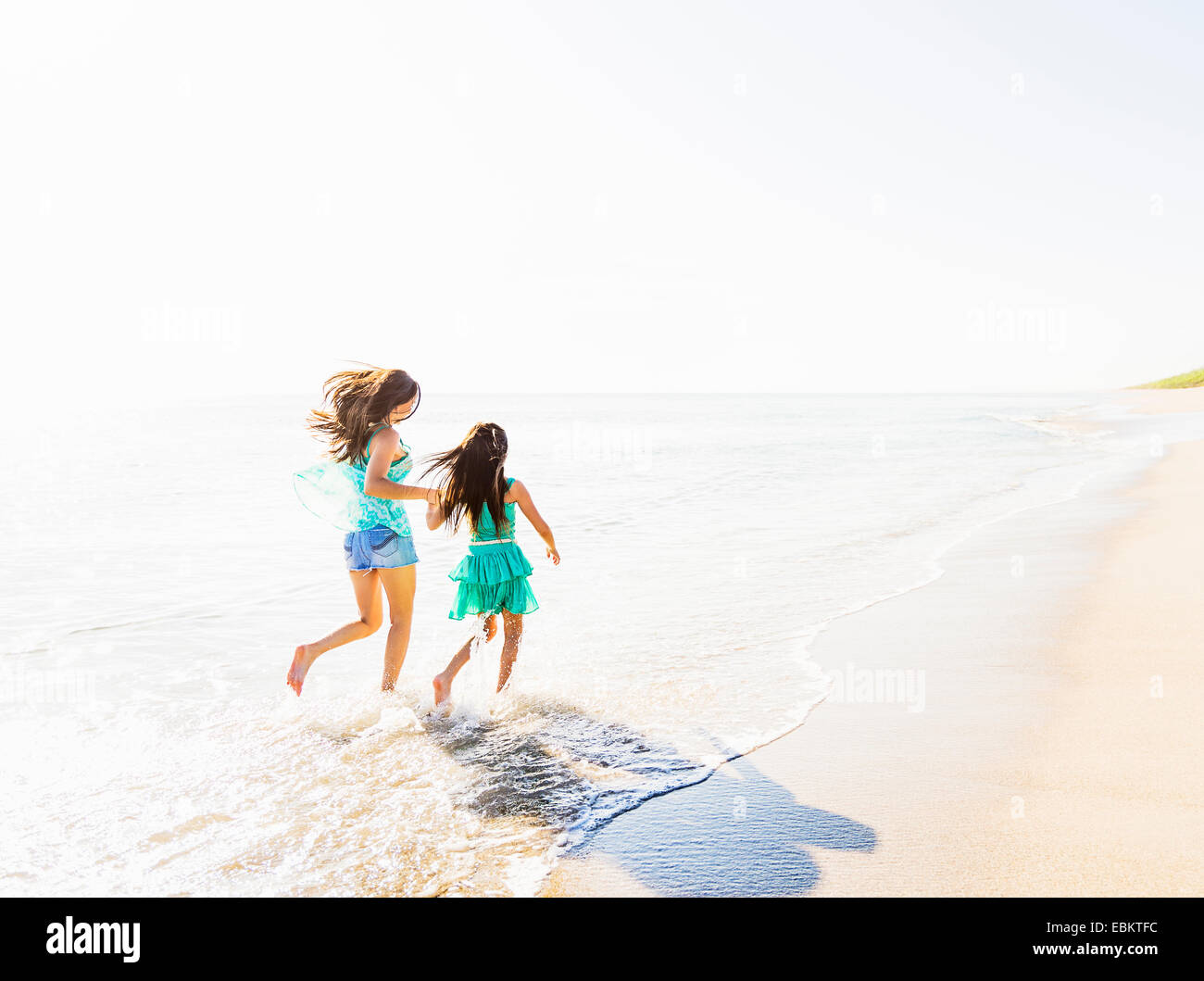 USA, Florida, Jupiter, Mom and daughter (6-7) spending time together on beach - Stock Image
