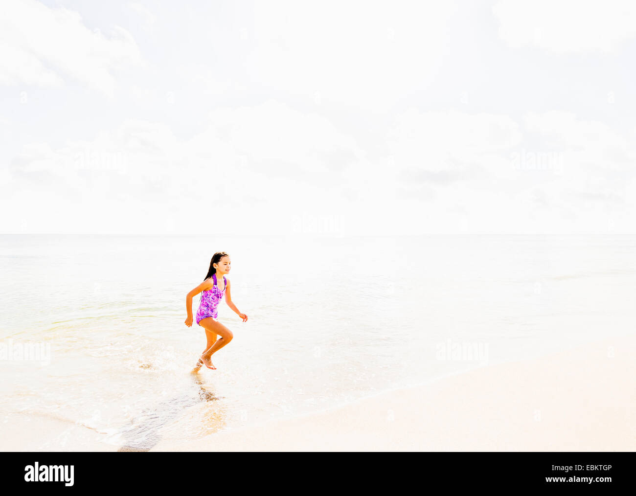 USA, Florida, Jupiter, Girl (6-7) running on beach -