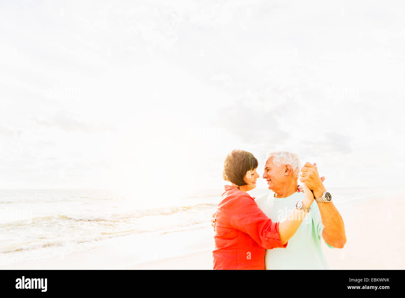 USA, Florida, Jupiter, Couple dancing on beach at sunrise - Stock Image