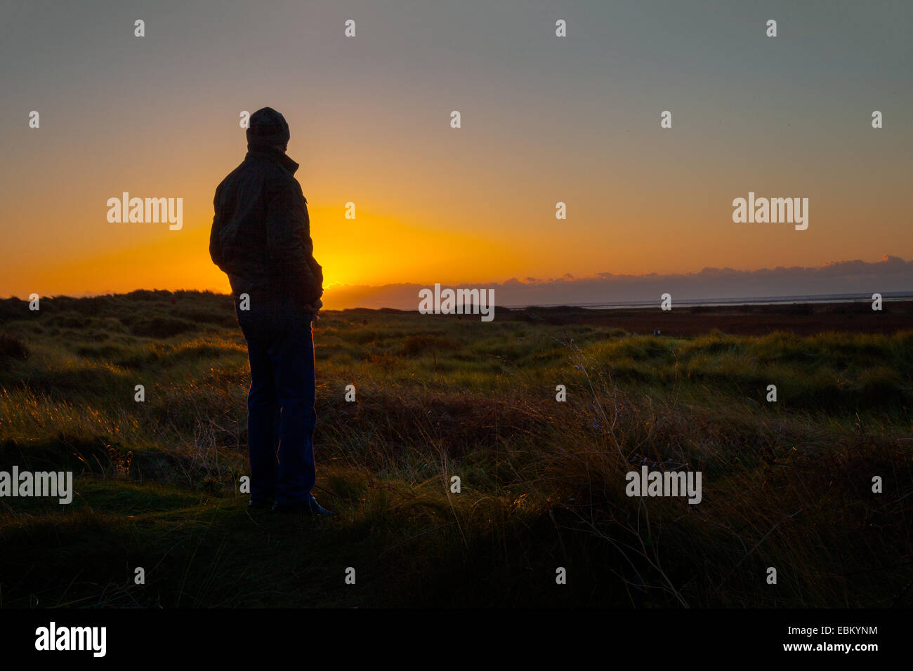 Sunset silhouette in Southport, Merseyside, UK. 2nd December, 2014.  Silhouetted man. UK Weather as seen at Ainsdale Stock Photo