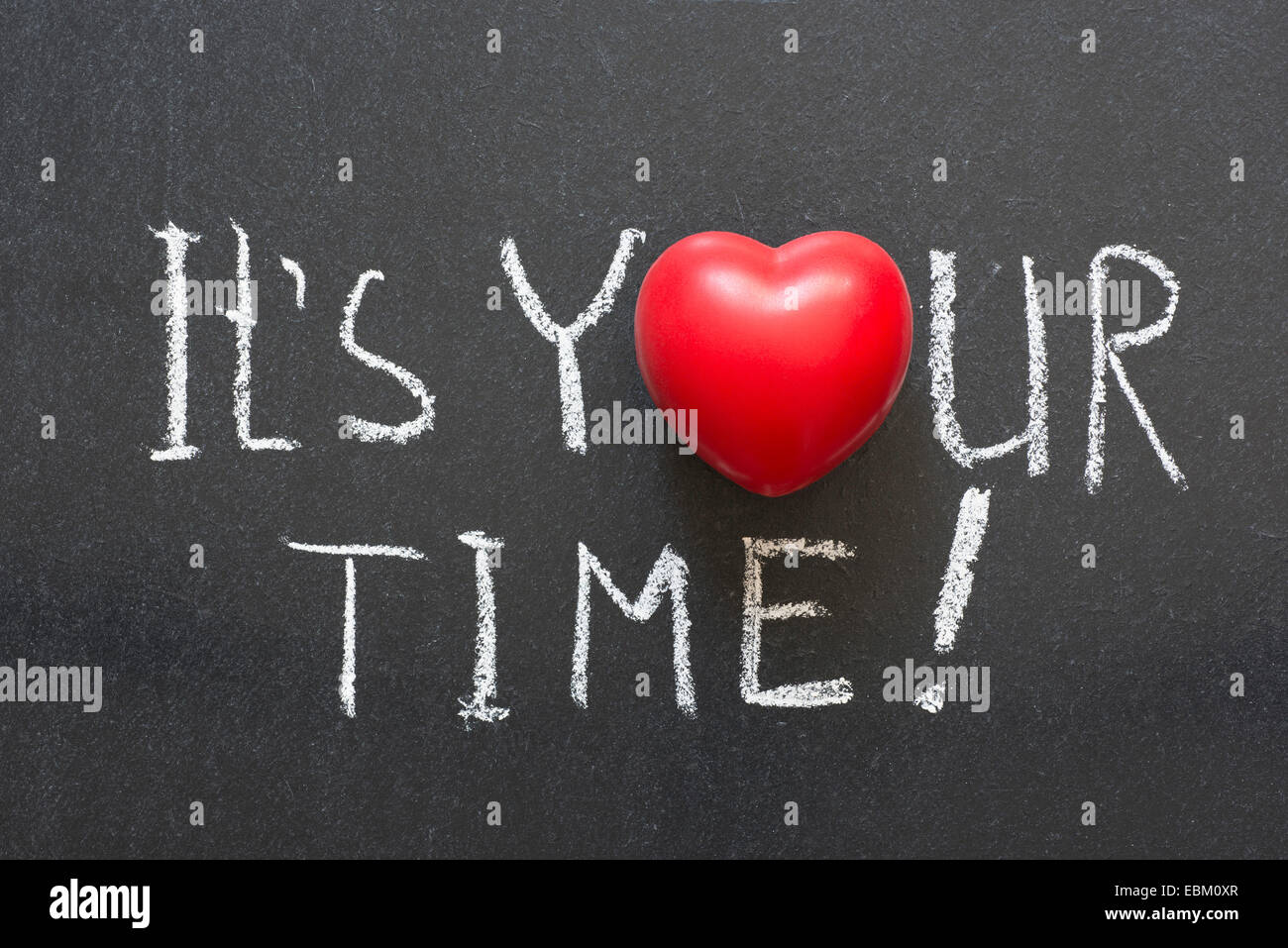 it is your time exclamation handwritten on chalkboard with heart symbol instead of O - Stock Image