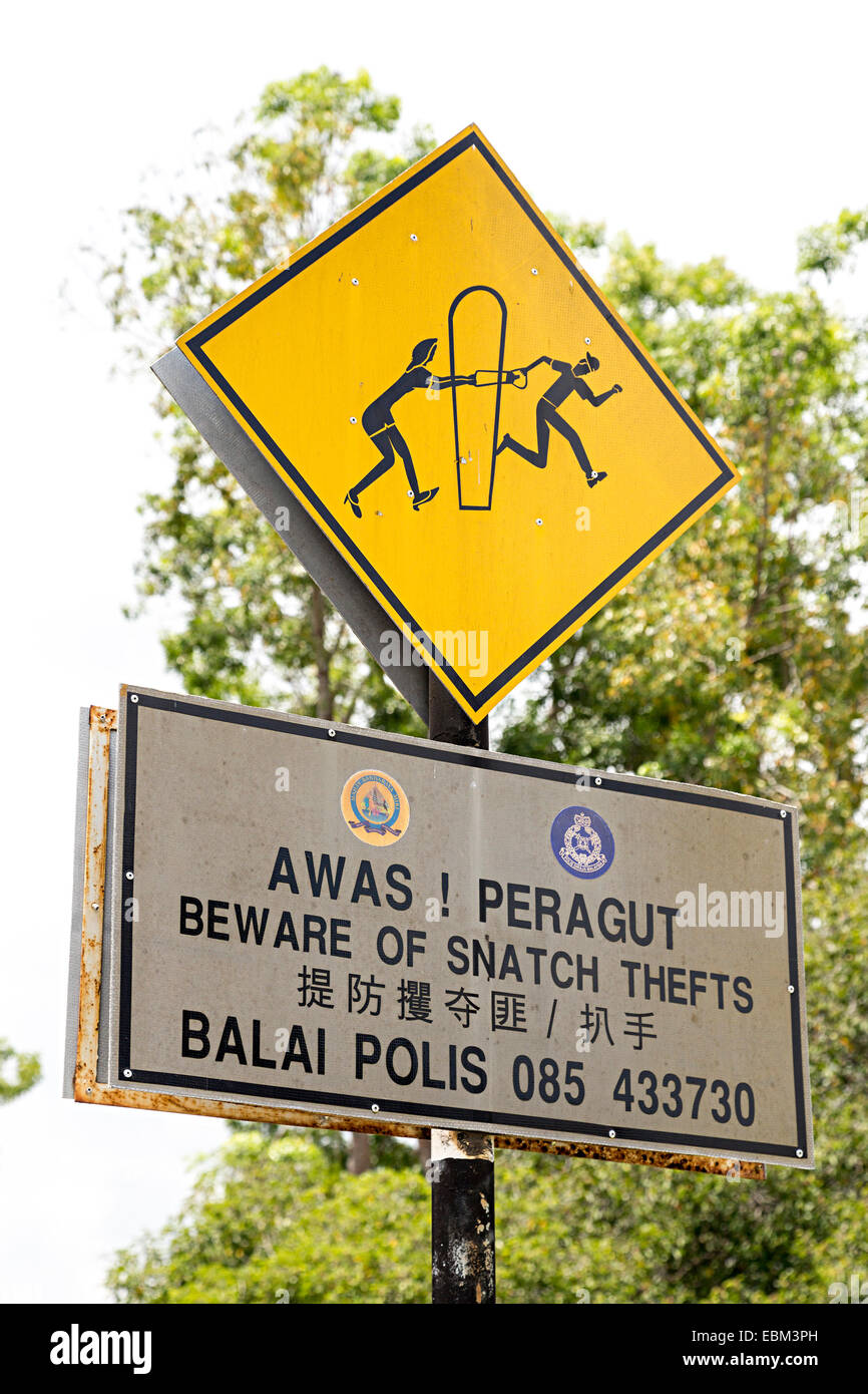 Warning road sign beware of snatch thefts, Miri, Malaysia - Stock Image