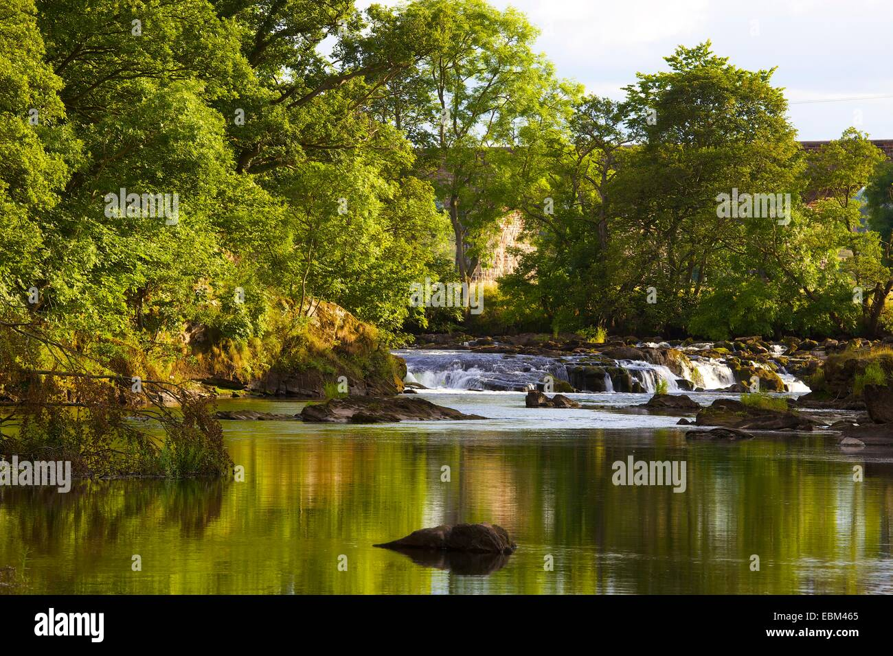 Weir at Force Mill, Eden Lacy, Eden Valley, Cumbria, England, UK. - Stock Image