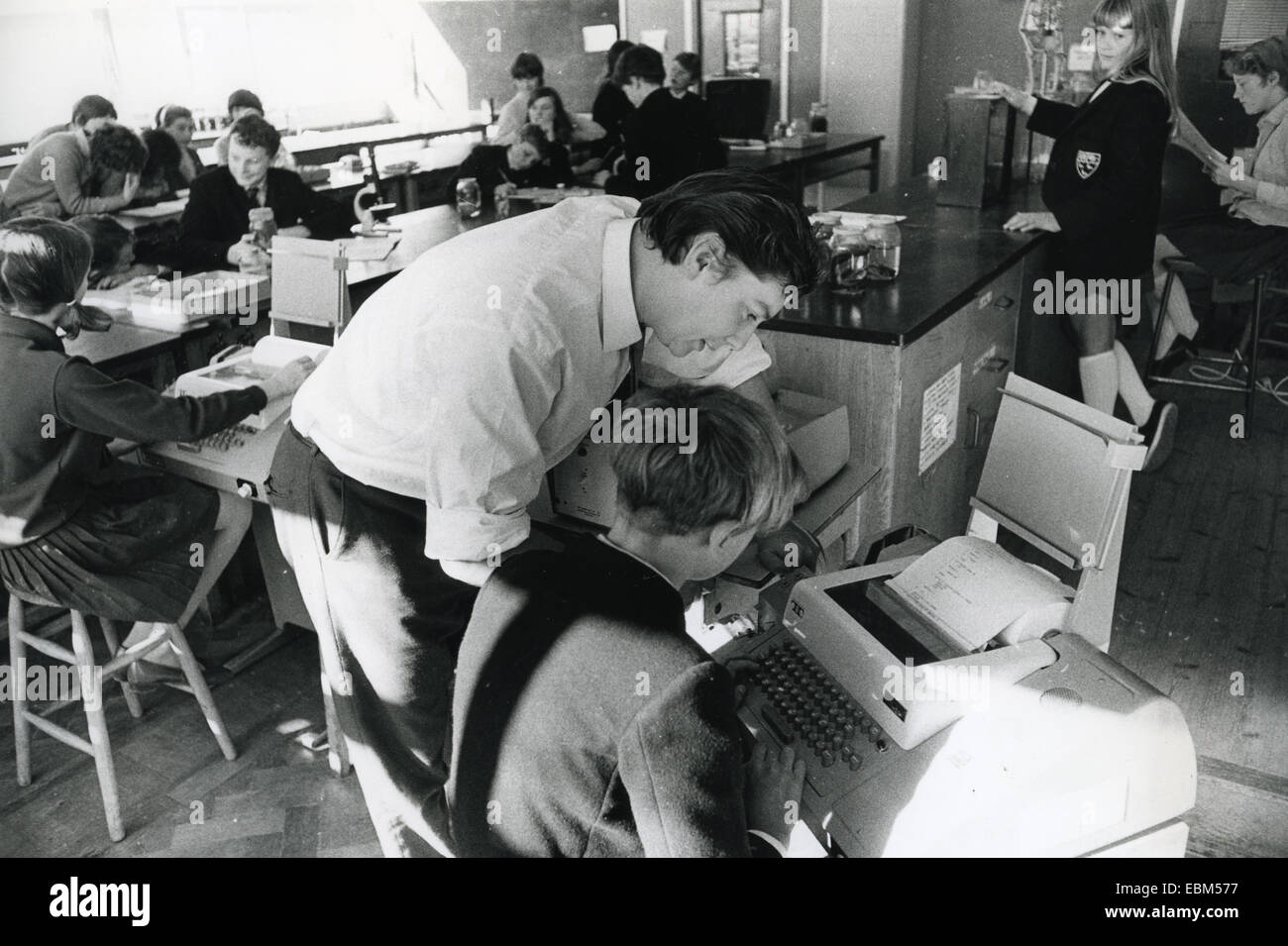 COMPUTERS IN SCHOOLS Pupils at the Thomas Bennett Comprehensive in Crawley, Surrey, using ICL 1900 computers in - Stock Image