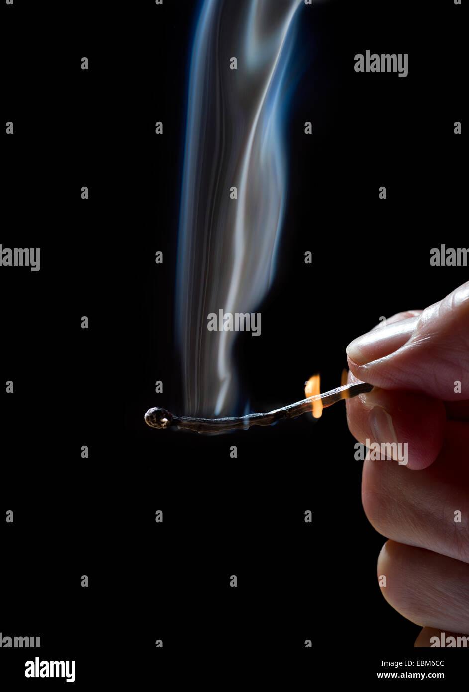 The burning match - Stock Image