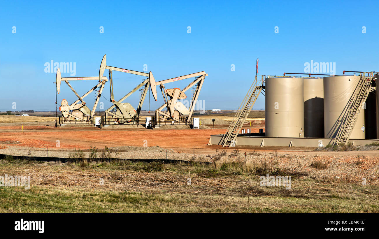Nodding Donkeys pump crude oil from strata. - Stock Image