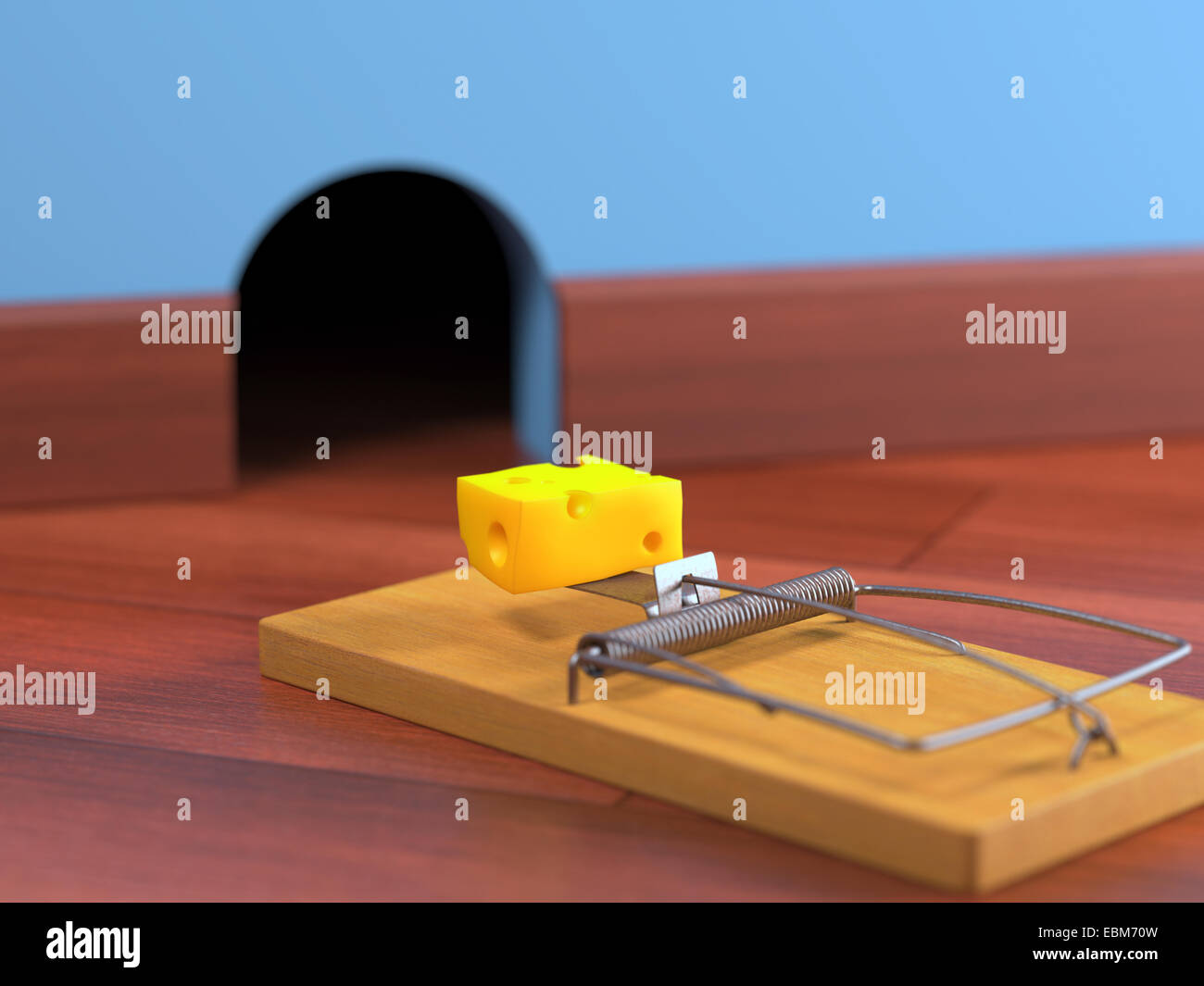 Mousetrap with cheese on a wooden floor. Depth of field in cheese. - Stock Image
