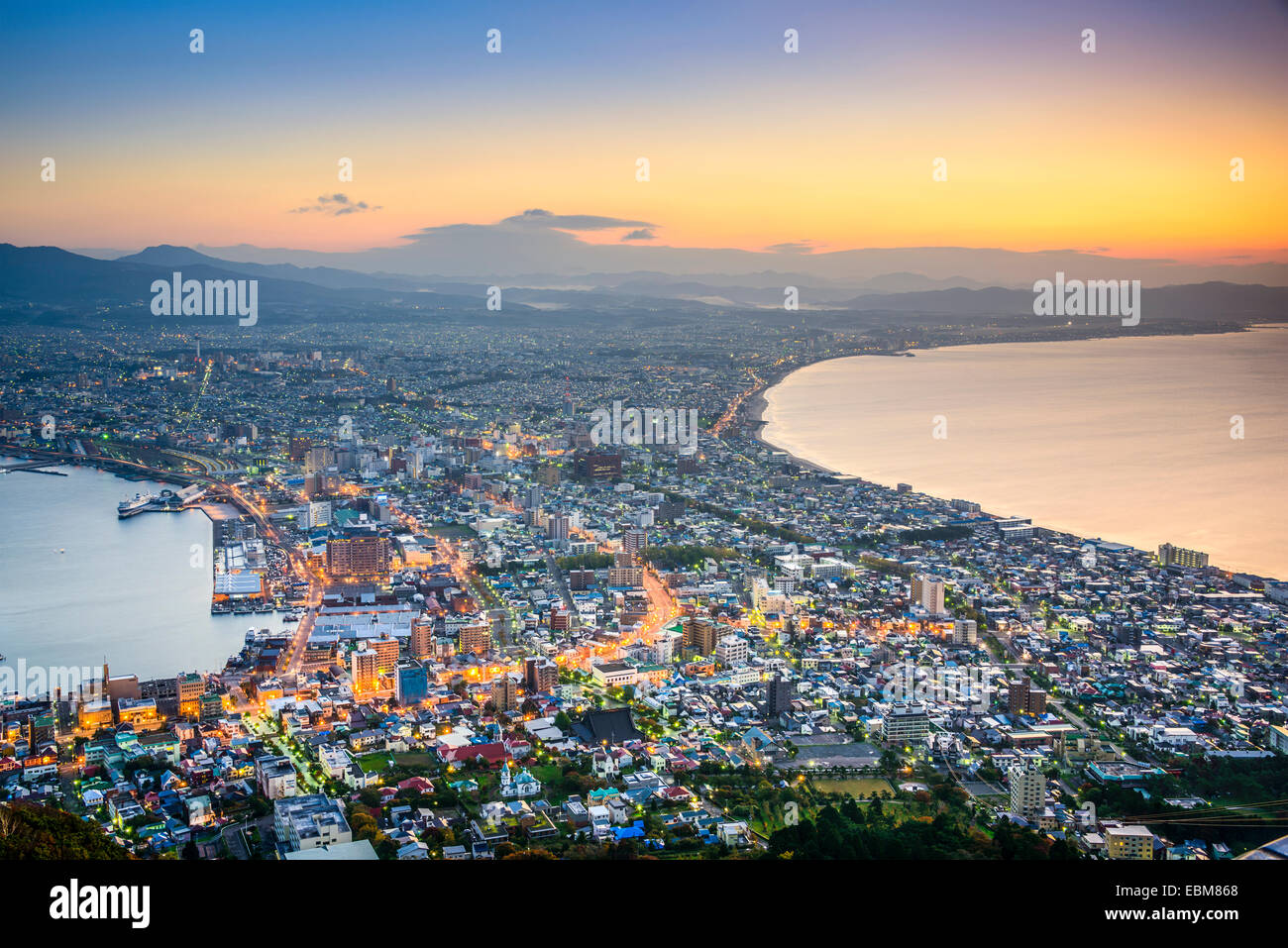 Hakodate, Hokkaido, Japan city skyline from Mt. Hakodate at dawn. The view is considered one of the three best in - Stock Image