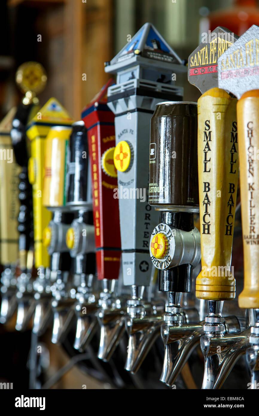 Beer taps, Santa Fe Brewing Company tasting room, Santa Fe, New Mexico USA - Stock Image