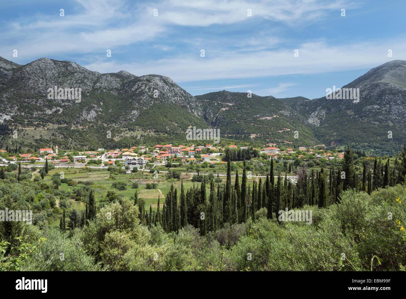 The beautiful greek village of Agios Nikolaos sits in the mountains, Kefalonia. Stock Photo