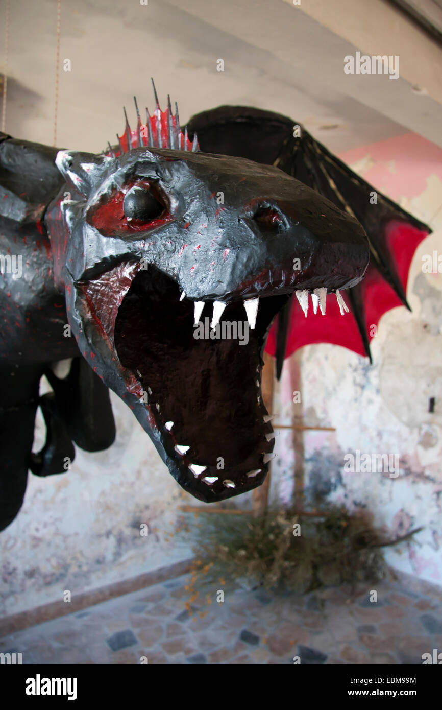 Black dragon with red wings and white teeth sculpture - Stock Image