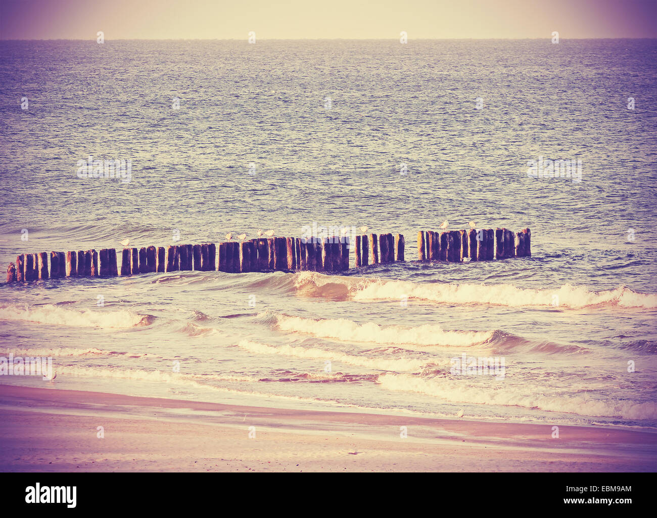 Vintage retro filtered picture of a beach, peaceful background. - Stock Image