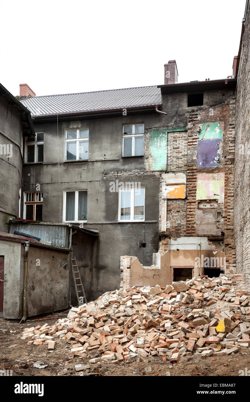 Abandoned, decayed and partly demolished building in Bialogard, Poland. - Stock Image