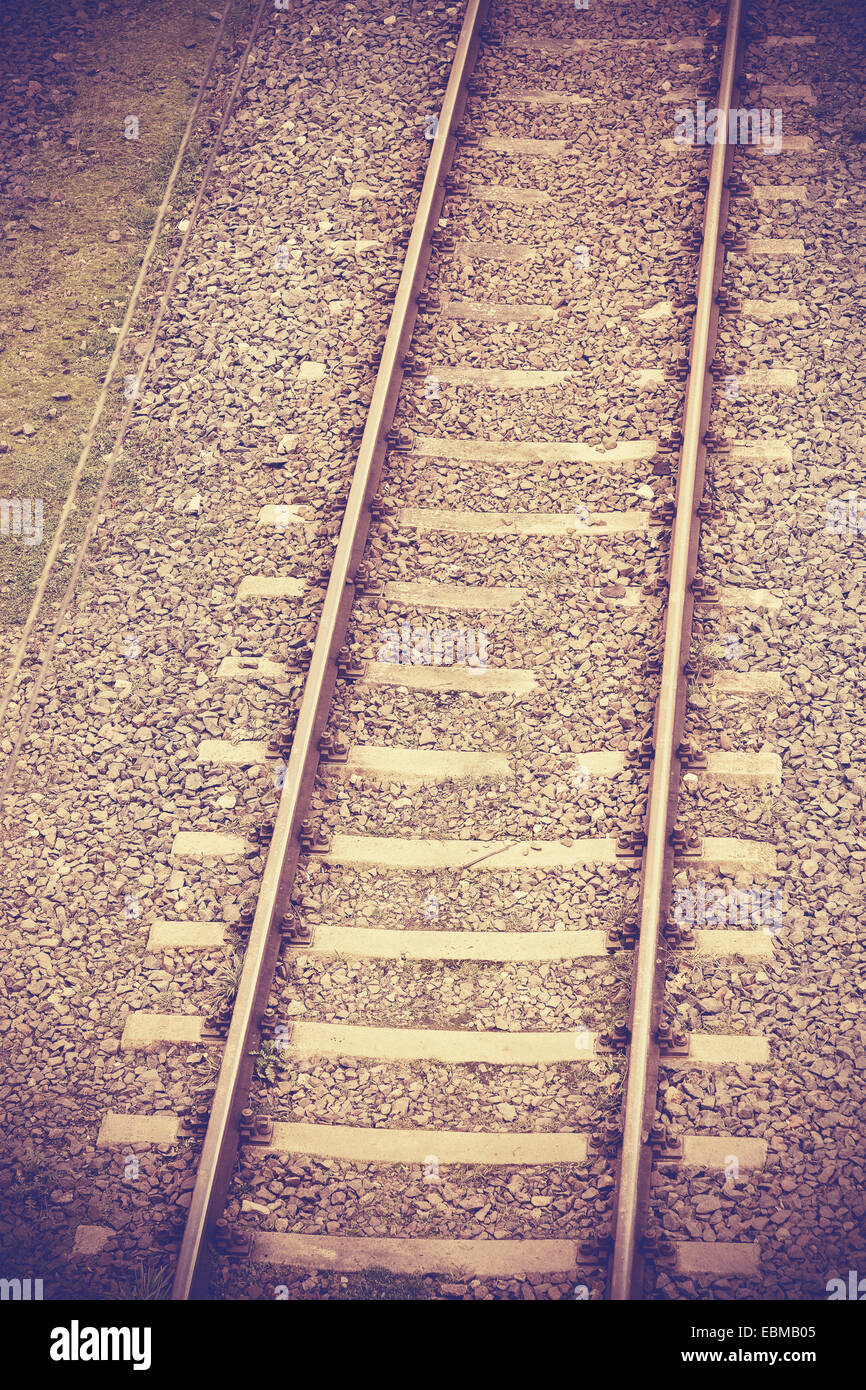 Vintage retro filtered picture of railway tracks. - Stock Image