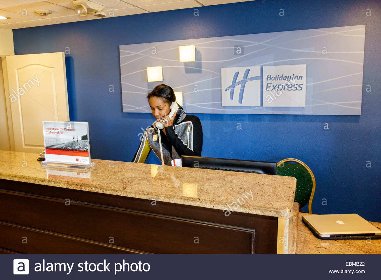 Delightful Clermont Florida Holiday Inn Express Motel Lobby Front Desk Reception Black  Woman Employee Job