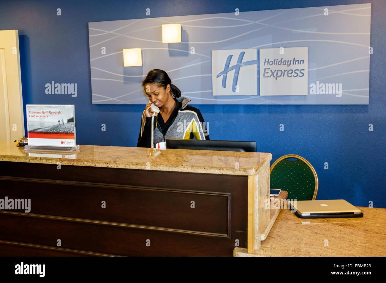 Clermont Florida Holiday Inn Express Motel Lobby Front Desk Reception Black  Woman Employee Job