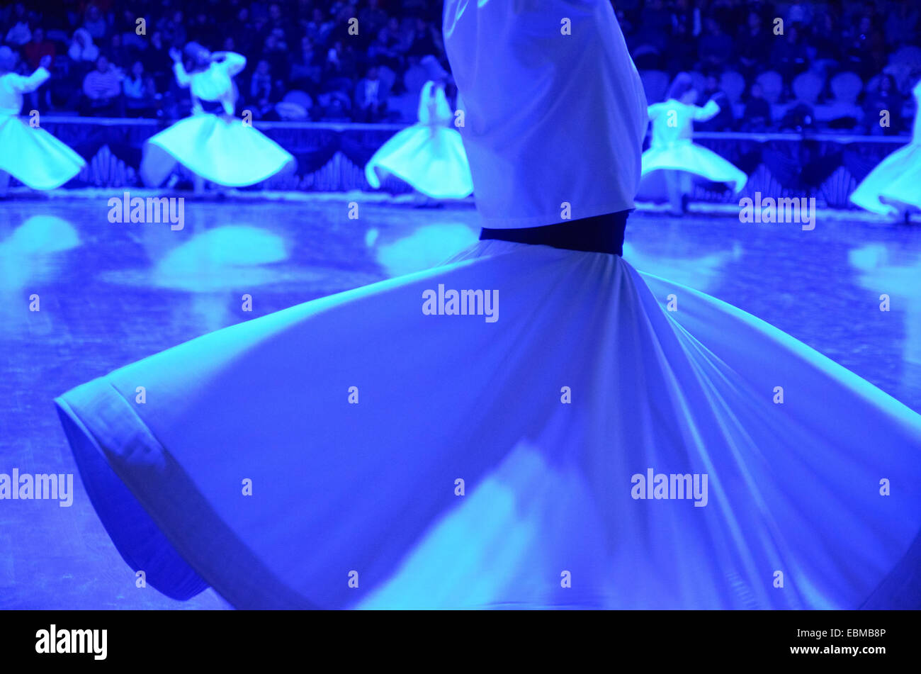 Whirling dervishes perform the Mevlevi Sema Ceremony at 740th anniversary of the death of Sufi teacher Mevlana Jalaladdin - Stock Image