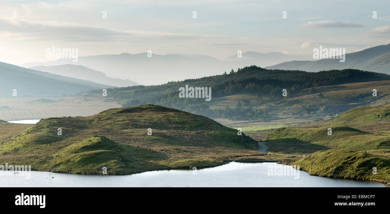 A hazy sunrise over Llyn Dywarchen, Snowdonia, Wales Stock Photo
