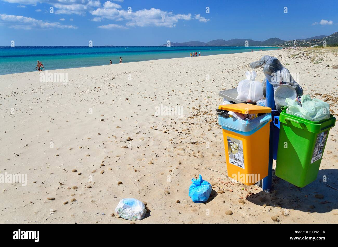 Overflowing trash cans on the beach, Costa Rei, Cagliari, Sardinia, Italy Province - Stock Image