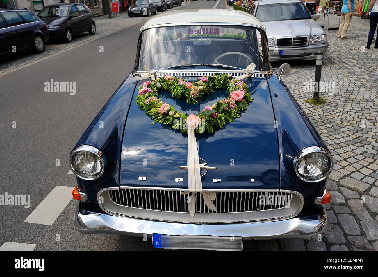 Vehicle decorations stock photos vehicle decorations stock images blue opel rekord p1 car in use as a wedding car with floral decorations on junglespirit Gallery