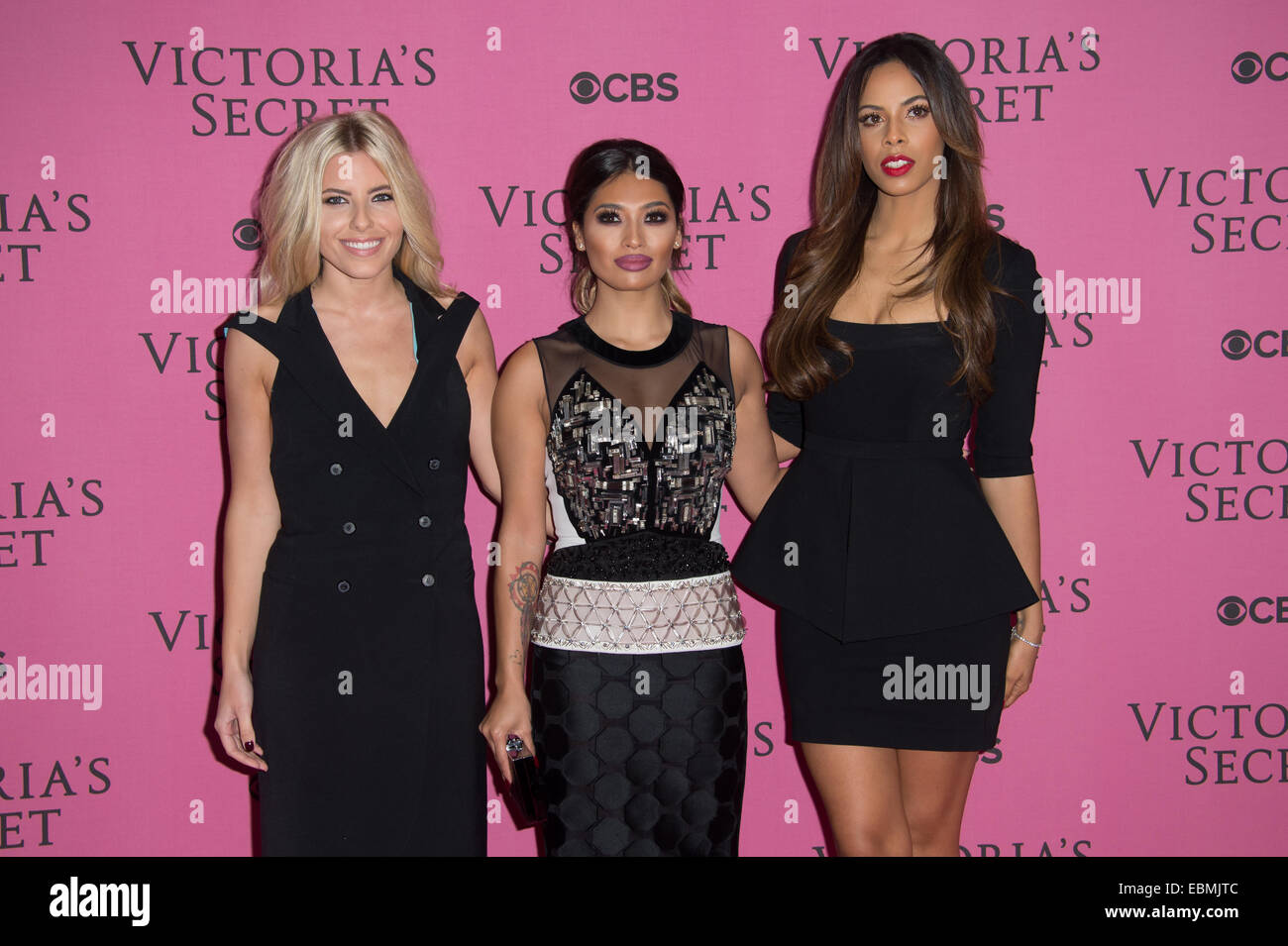 Mollie King, Vanessa White and Rochelle Humes of The Saturdays at the Victoria's Secret fashion show in London. - Stock Image