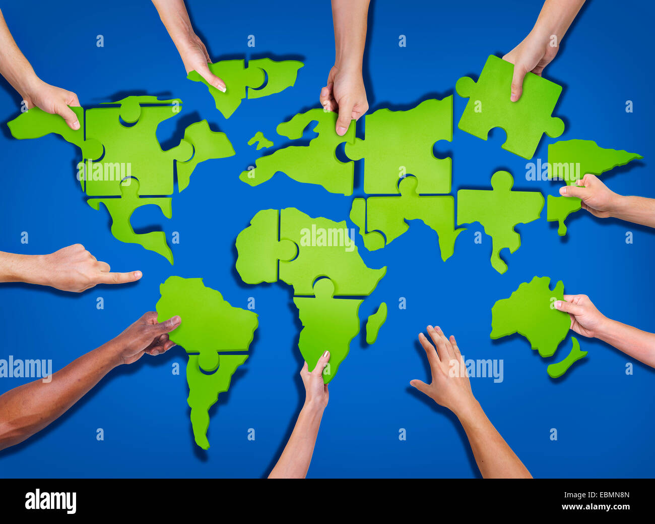 Asia map puzzle stock photos asia map puzzle stock images alamy aerial view of people forming world map with puzzle pieces stock image gumiabroncs Image collections
