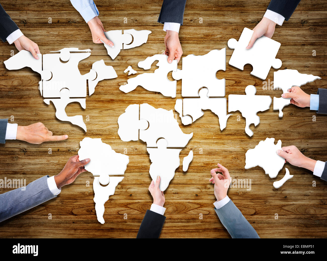 Jigsaw puzzle world map stock photos jigsaw puzzle world map stock group of business people with jigsaw puzzle forming in world map stock image gumiabroncs Image collections