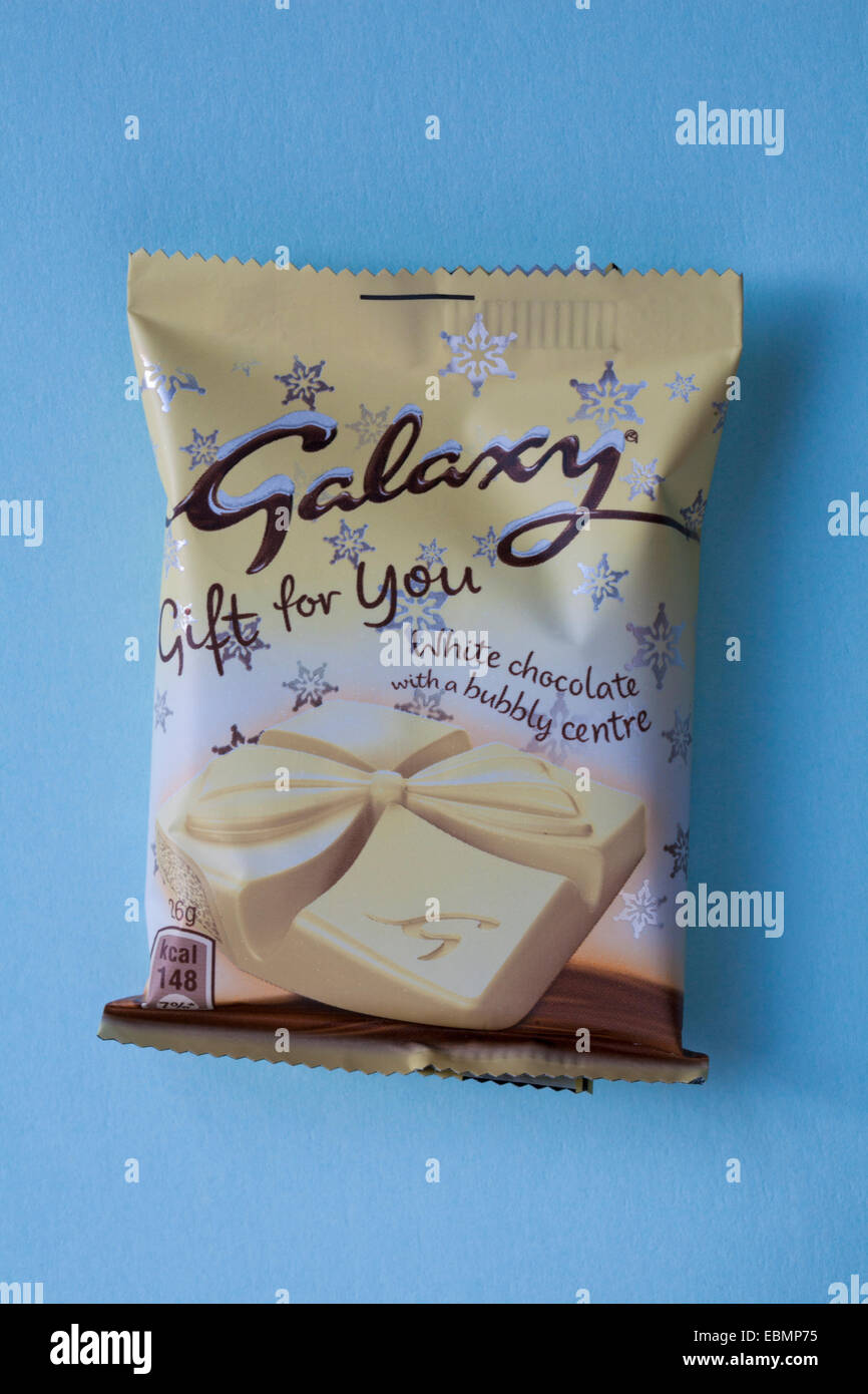 Galaxy Gift for You white chocolate with a bubbly centre isolated on blue background - Stock Image
