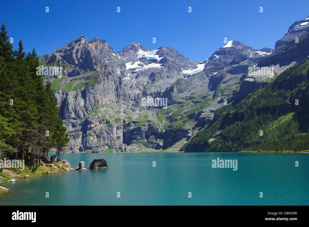 lake Oeschinen near Kandersteg with Bluemlisalp, Switzerland - Stock Image