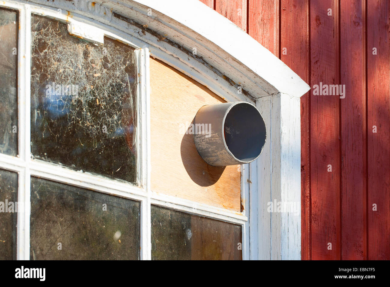 in a window built-in tube, pipe as an opening to the inside of a shed, hollow cavities as a hiding place, access - Stock Image