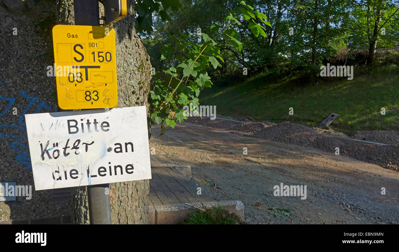 sign labeled 'mutts on the lead', Germany - Stock Image