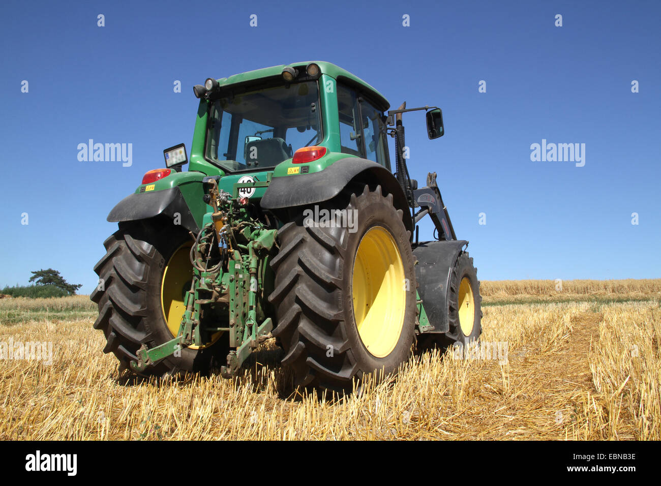 tractor on stubble field, Germany - Stock Image